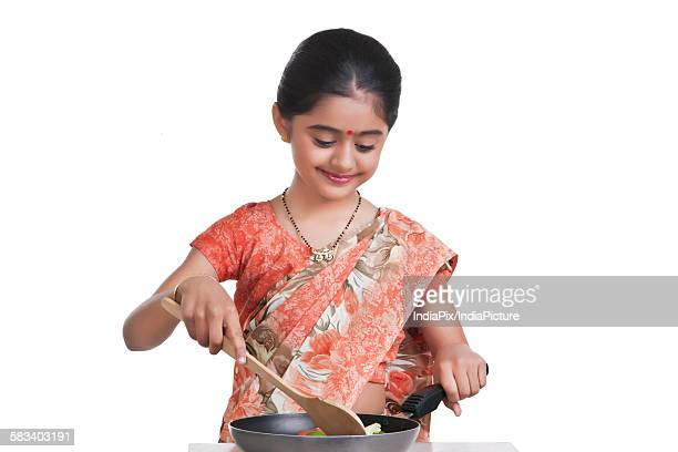 little girl dressed as housewife cooking - mangala sutra fotografías e imágenes de stock