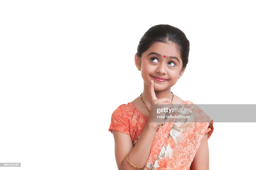 Little girl dressed as housewife thinking : Stock Photo