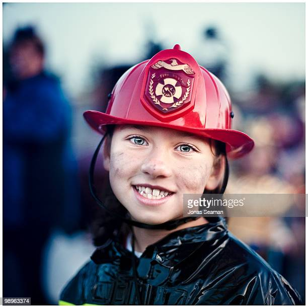 Little girl dressed in a fire fighter costume