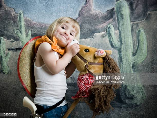 little girl dressed up as a cowgirl