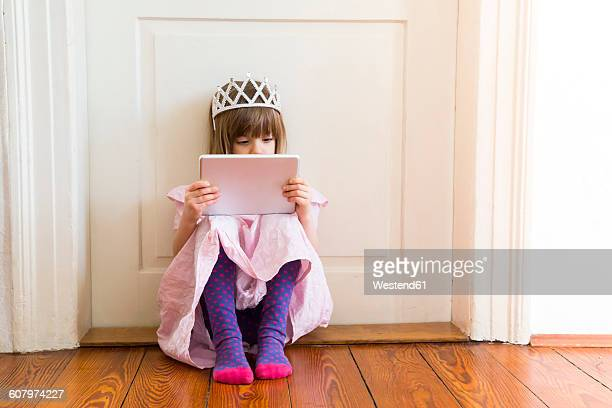 little girl dressed up as a princess looking at digital tablet - little girls dressed up wearing pantyhose stock photos and pictures