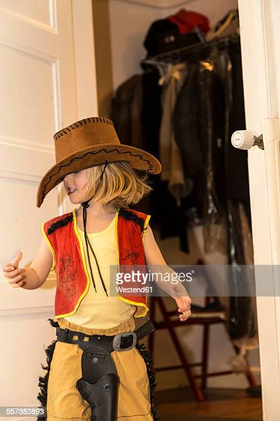 Little girl dressed up as cowboy