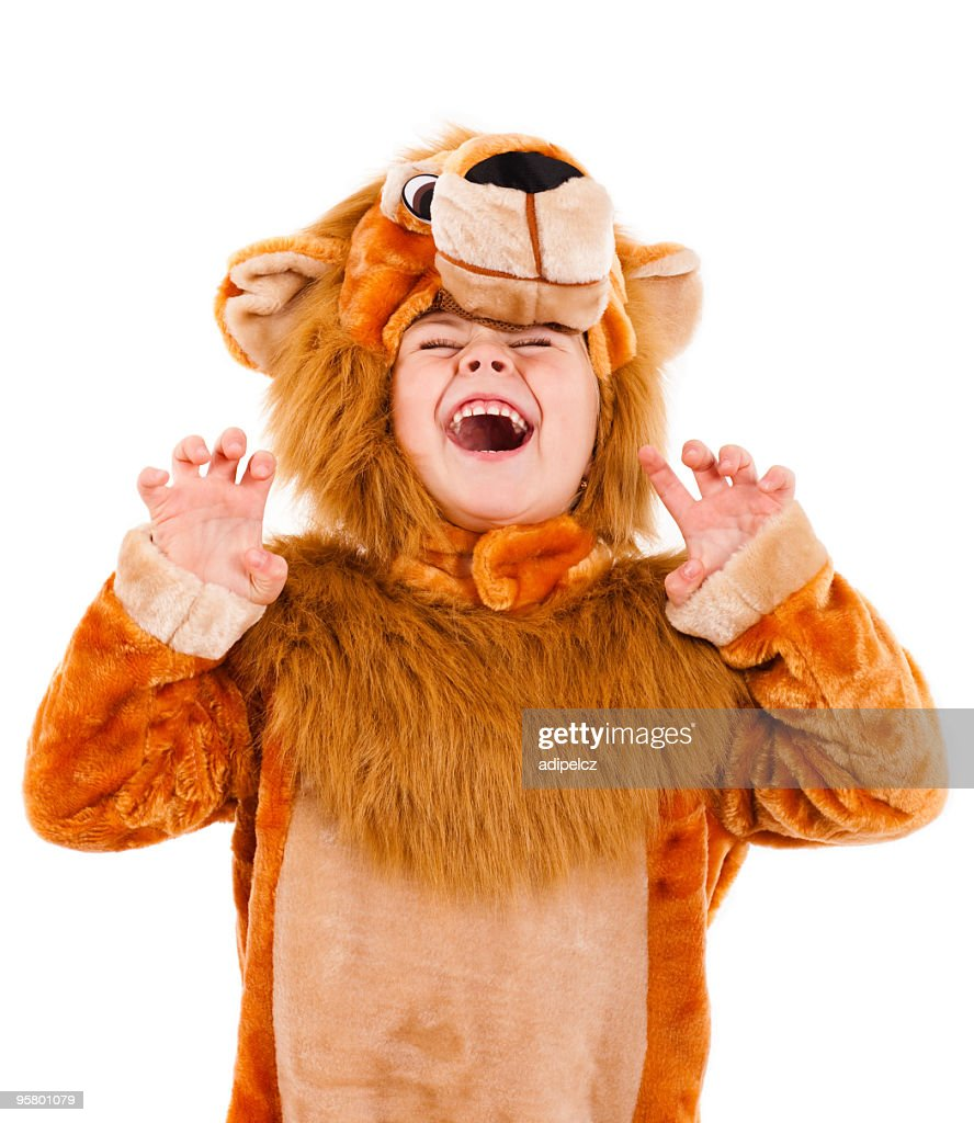 A little girl dressed up in a lion costume : Stock Photo
