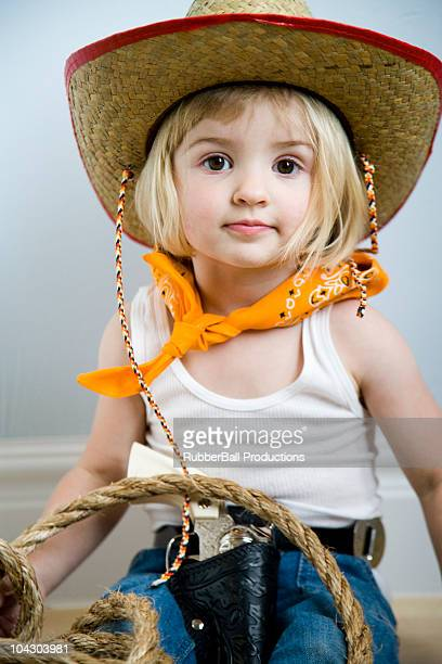 little girl dressing up as a cowgirl
