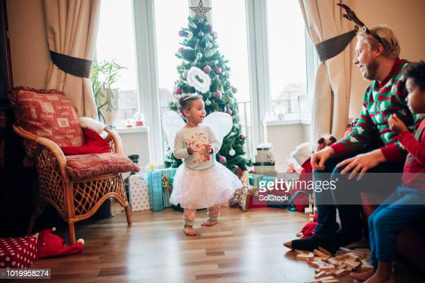 Little Girl Dressing Up as an Angel at Christmas
