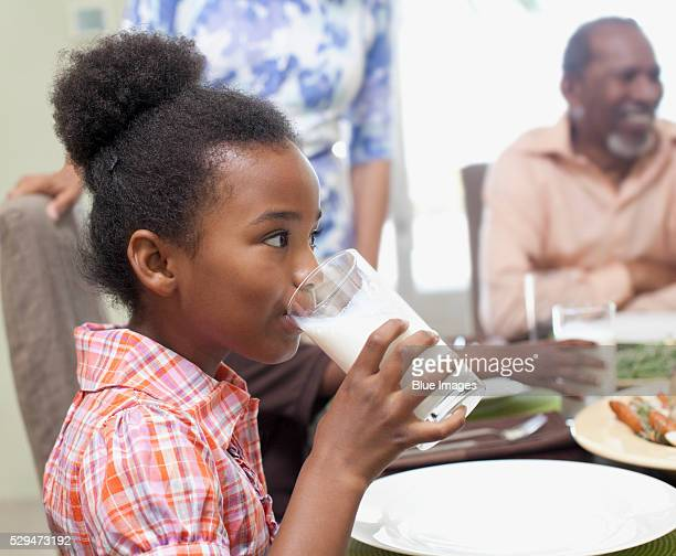 Little girl drinking a glass of milk