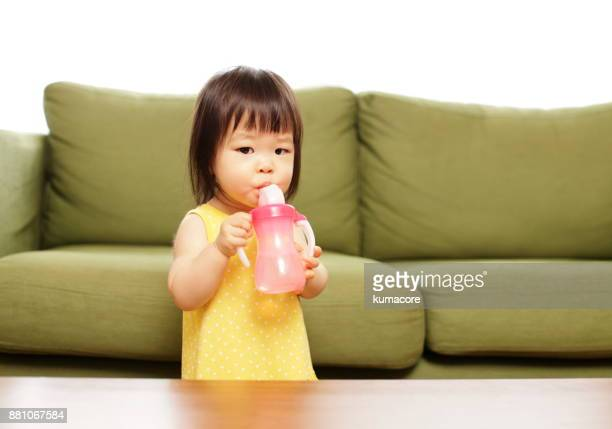 Little girl drinking a water
