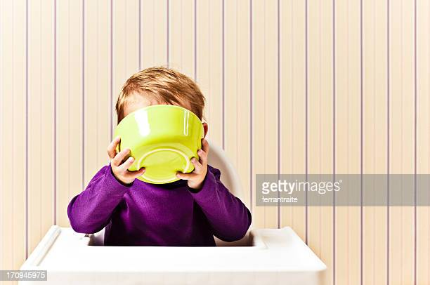 Little Girl drinking from cereal bowl