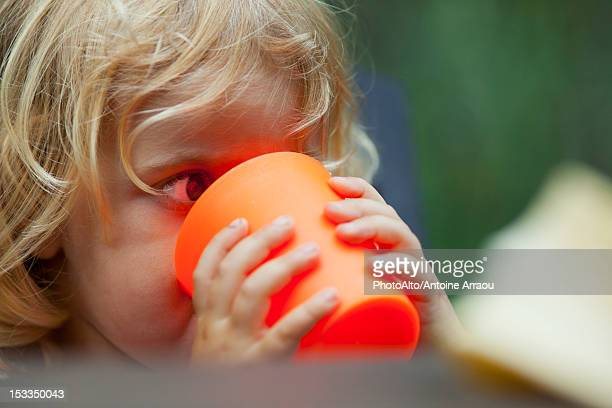 Little girl drinking from cup