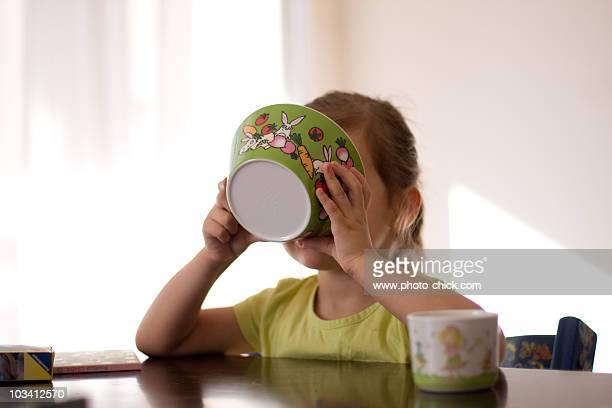 Little Girl Drinking Soup