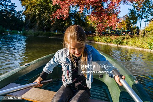 Cambodian Little Girl Rowing A Boat Tonle Sap Cambodia