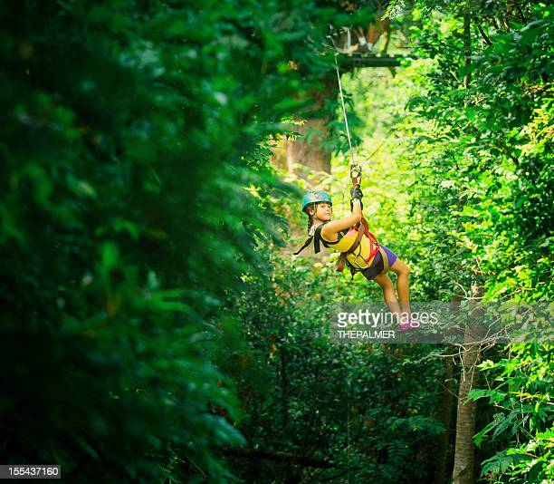 little girl during a canopy tour costa rica - costa rica stock photos and pictures