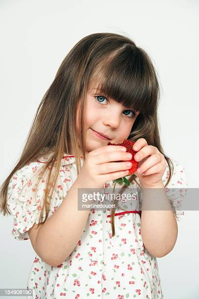 "little girl eating a fresh strawberry. - ""martine doucet"" or martinedoucet stock pictures, royalty-free photos & images"