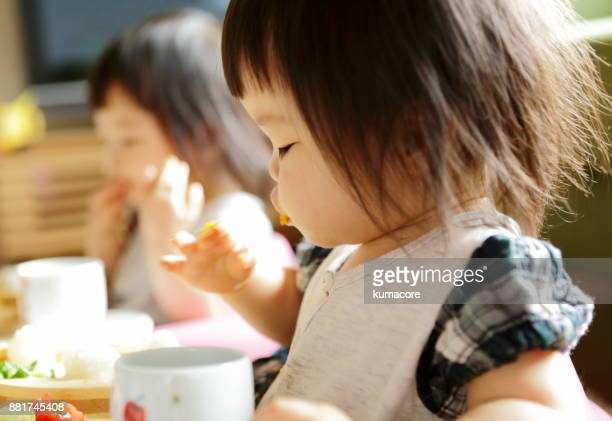 Little girl eating a meal,close up