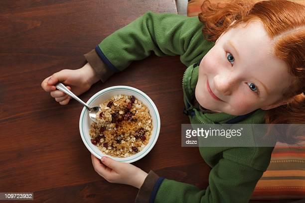 little girl eating breakfast cereal
