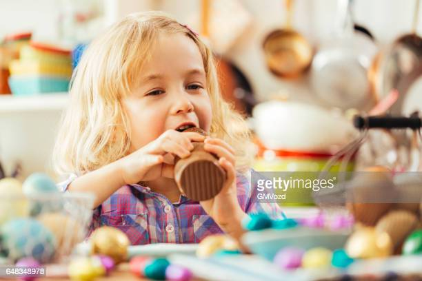 Little Girl Eating Chocolate Easter Bunny