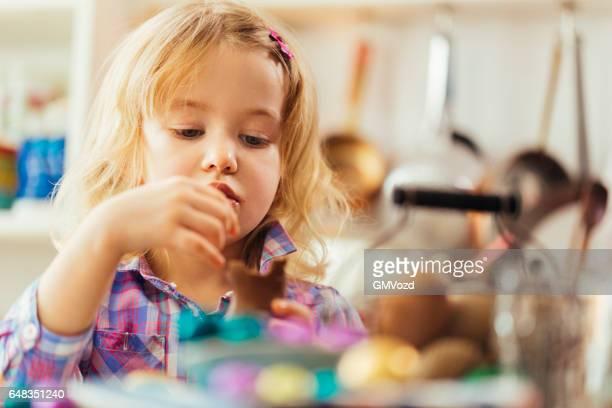 Little Girl Eating Chocolate Easter Bunny