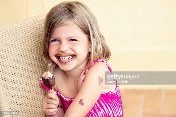 Little girl eating chocolate ice cream