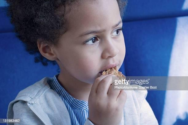 Little girl eating cookie, portrait