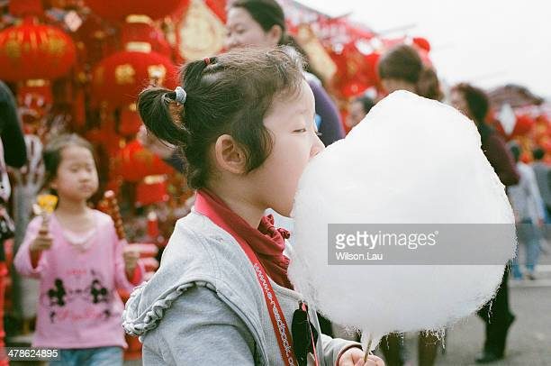 Little girl eating cotton candy