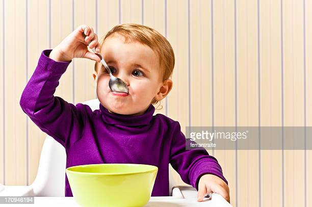 Little Girl eating from cereal bowl