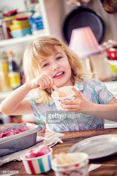 Little Girl Eating Homemade Strawberry Ice Cream
