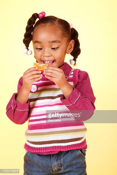 Little Girl Eating Orange