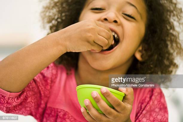 little girl eating snack - bowl of candy stock photos and pictures