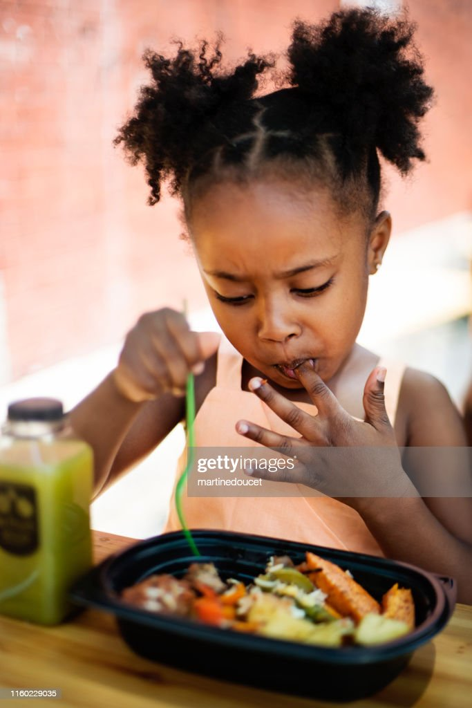 Little girl eating take out food outdoors. : Stock Photo