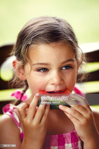 little girl eating watermelon - rebecca nelson stock pictures, royalty-free photos & images