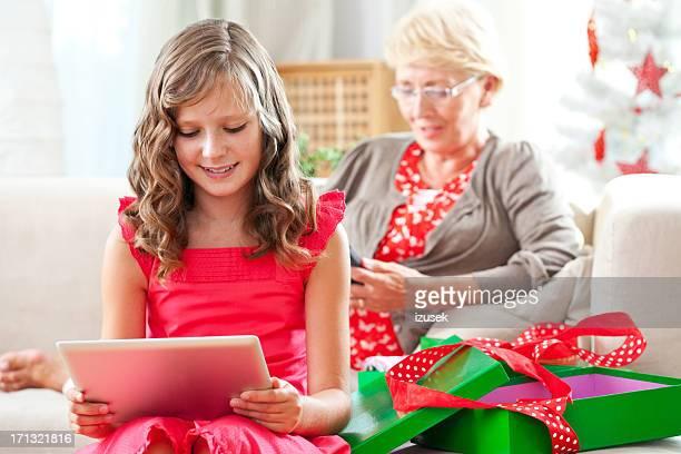 little girl enjoying christmas present - izusek stockfoto's en -beelden