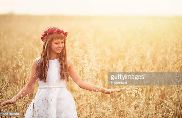 Little girl enjoying grain field