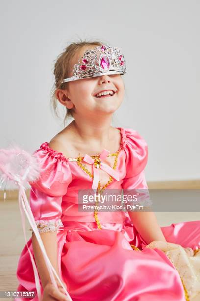 little girl enjoying her role of princess. adorable cute 5-6 years old girl wearing princess dress - princess stock pictures, royalty-free photos & images