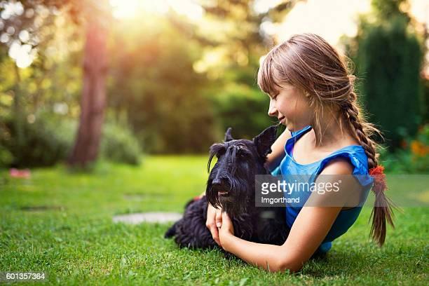 Little girl enjoying summer with her dog.