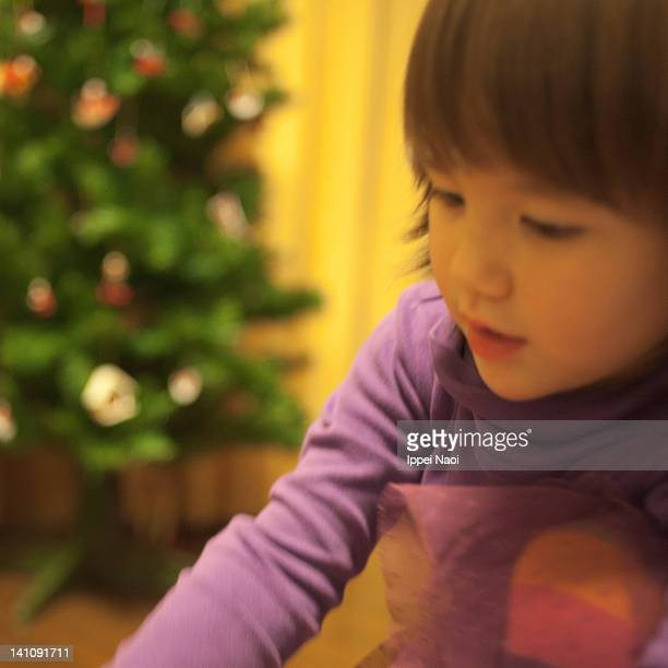 little girl excited with her christmas gift - ippei naoi stock photos and pictures
