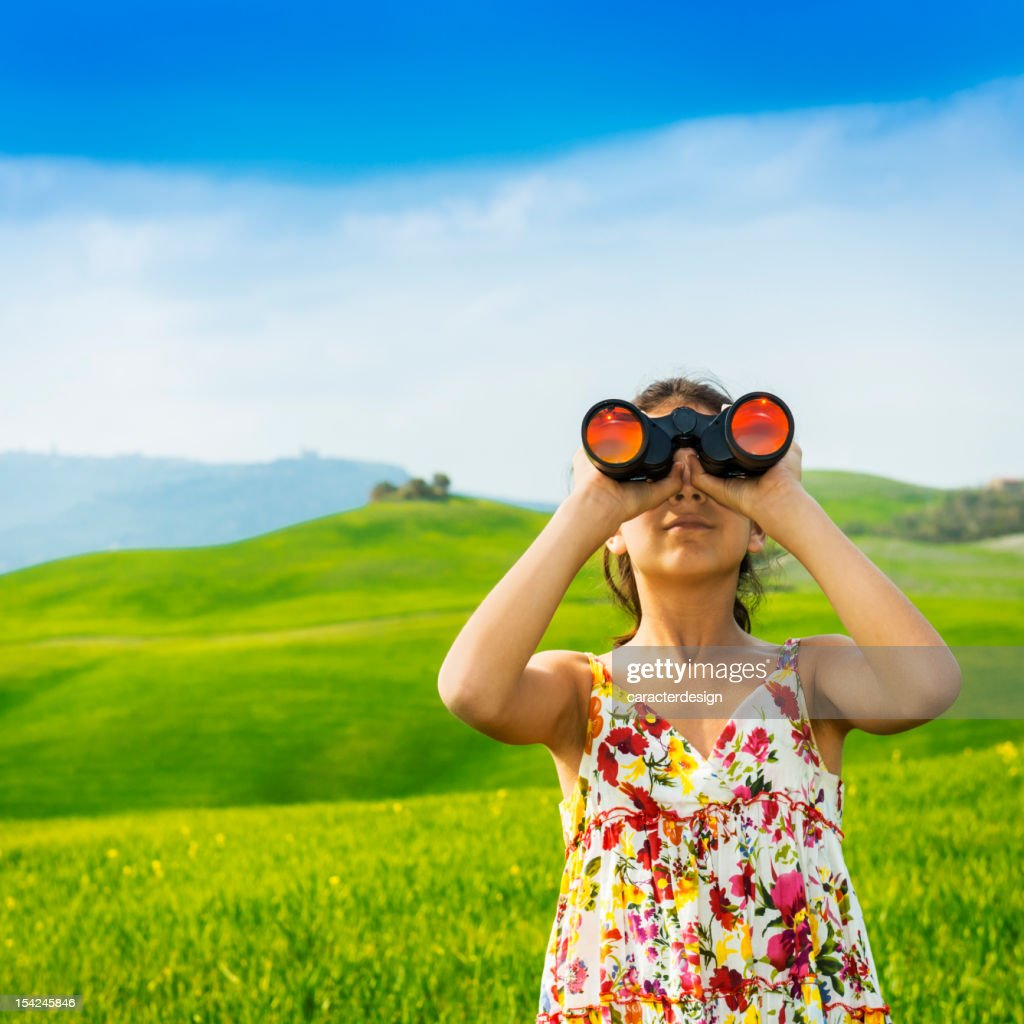 Little girl exploring with binoculars in Tuscany -Italy : Stock Photo