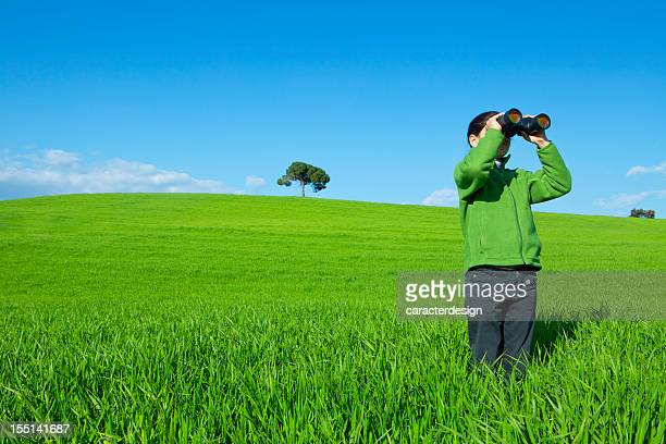 Little girl exploring with binoculars