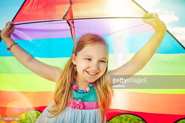 Little girl flying a kite