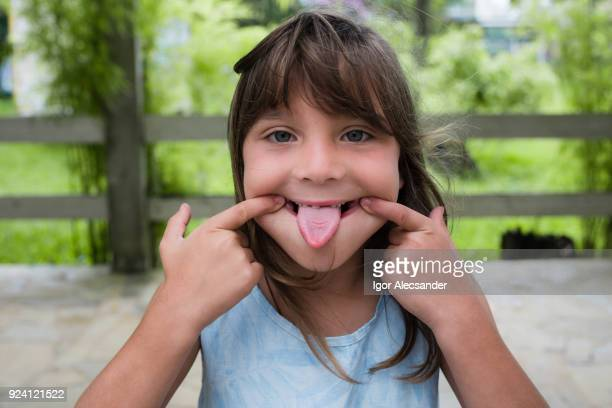 little girl fun tongue - human tongue stock pictures, royalty-free photos & images