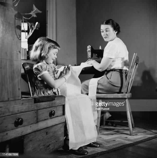 A little girl gets her 'dream' dress handmade and tailored by a dressmaker at a McCall Pattern Company shop US circa 1950
