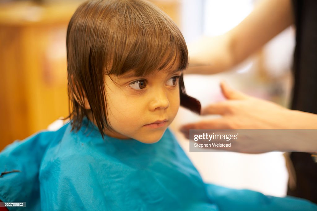 Little Girl Getting A Haircut Stock Photo Getty Images