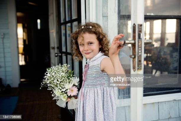 """little girl getting out of beach house for small wedding. - """"martine doucet"""" or martinedoucet stock pictures, royalty-free photos & images"""