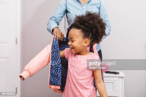 little girl getting ready for school - black jacket stock pictures, royalty-free photos & images