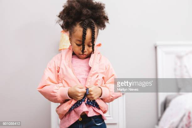 little girl getting ready for school - coat garment stock pictures, royalty-free photos & images
