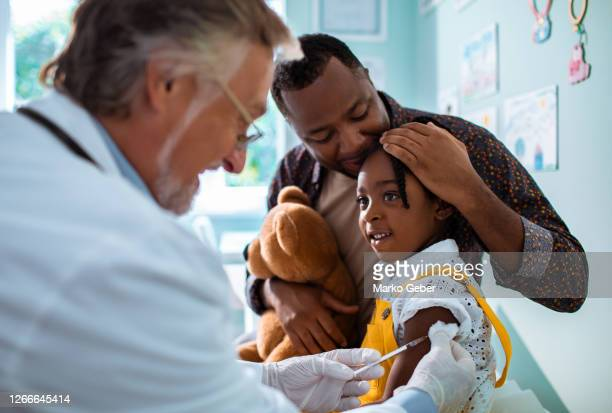 little girl getting vaccinated - medicine stock pictures, royalty-free photos & images