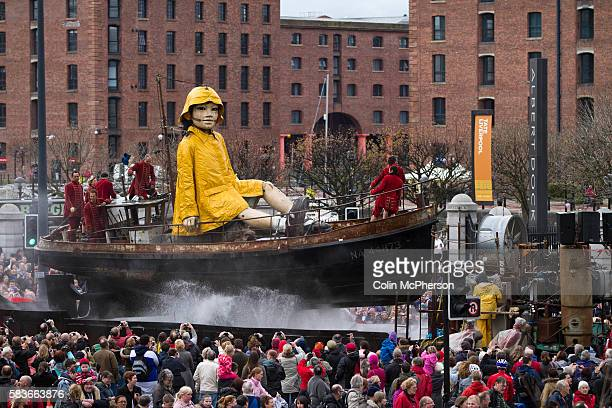 Little Girl Giant a 30foot high puppet making her way through the centre of Liverpool as part of the Sea odyssey Giant Spectacular The threeday event...
