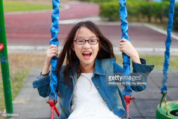 Little girl had a swing at elementary school in Pingtung, Taiwan.