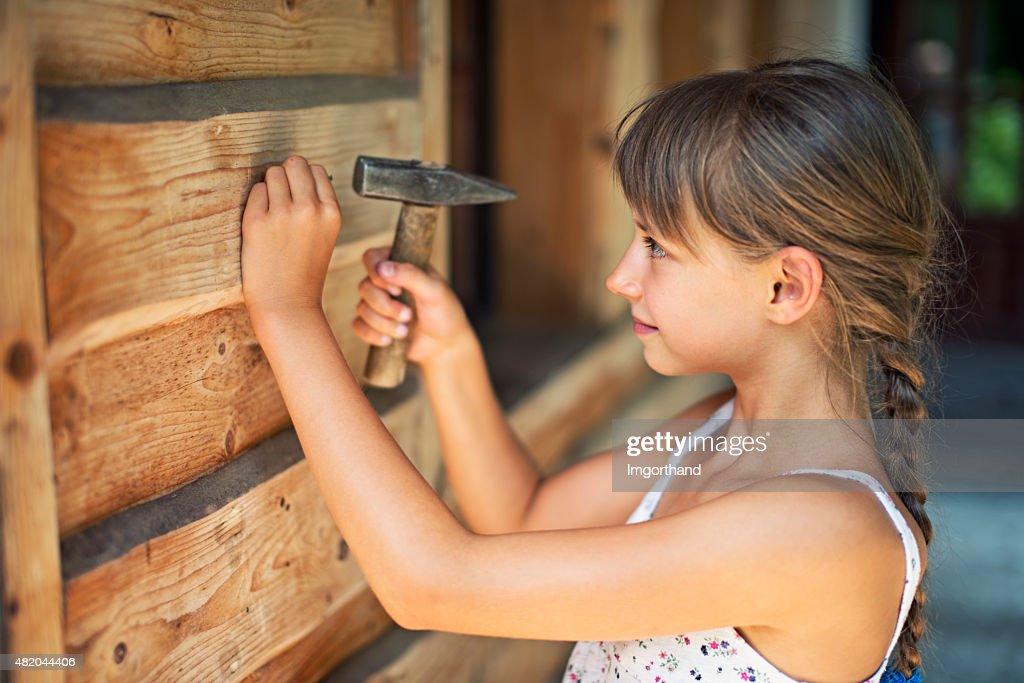 Teens hammering outside