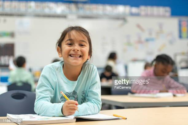 little girl hard working - school building stock pictures, royalty-free photos & images