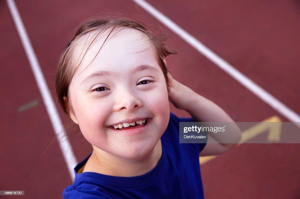Little girl have fun on stadium : Stock Photo